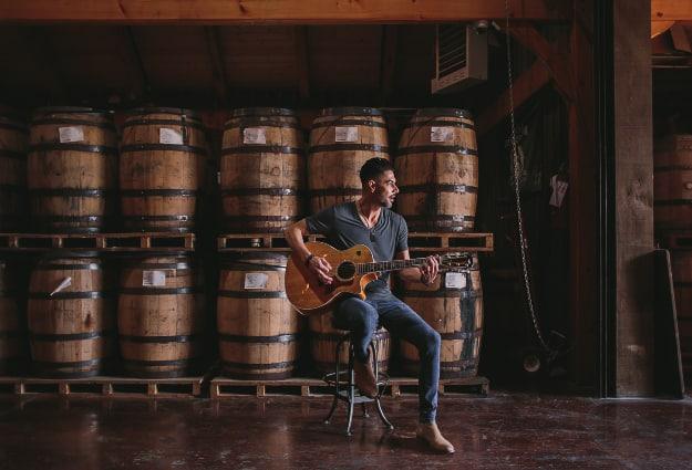 Pime Hernandez playing guitar at Leiper's Fork Distillery